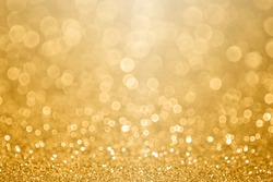 Abstract gold glitter sparkle confetti gala background or golden texture party invite for happy birthday, anniversary, wedding, new year's eve or Christmas celebration