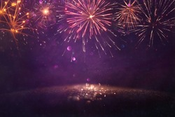 abstract gold, gold and purple glitter background with fireworks. christmas eve, 4th of july holiday concept
