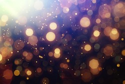 Abstract Golden glare on abstract bokeh background