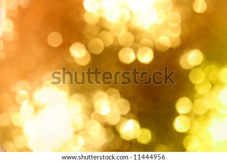 Abstract golden glow light background. Defocused shot of christmas ornament