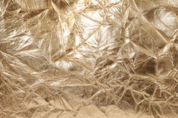 Abstract golden surface. Wrinkled leather background. Luxury material texture.