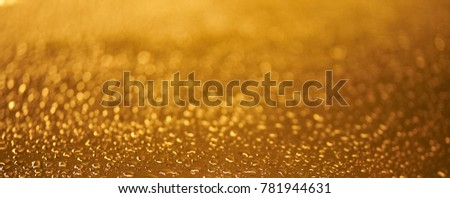 Abstract golden water droplet and bokeh #781944631