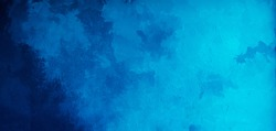Abstract gradient bright blue background. Panoramic grunge navy blue stucco wall background. Beautiful Wide angle rough stylized texture wallpaper with copy space for design