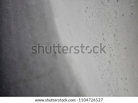 Abstract gray background. Gray background. Gray surface.