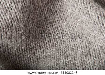 abstract gray background with a knitted fabric