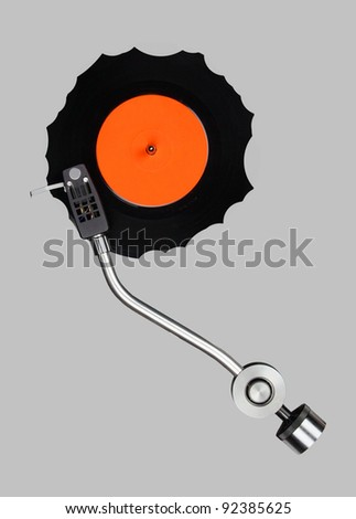 Abstract grazed vinyl with record player tonearm isolated.