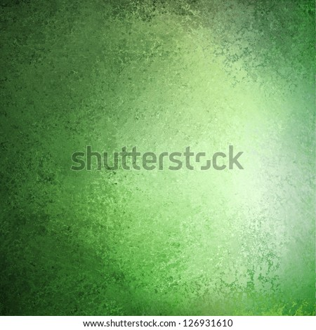 abstract green background pastel Easter color or spring color of mint green, faint vintage grunge background texture gradient design, bright whiter center spot, old green paper faded darker edges