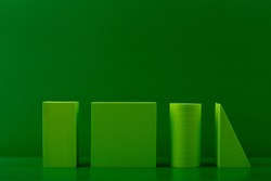 Abstract green monochromatic with green geometric figures against green background with copy space