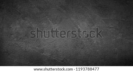 Abstract Grunge Black Stucco Wall Background. Monochrome Rough Surface Plaster Texture. Wide Angle gray Wallpaper Close up With Copy Space for design