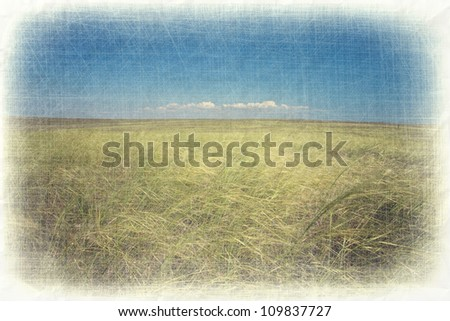 Abstract grunge countryside landscape background with paper texture