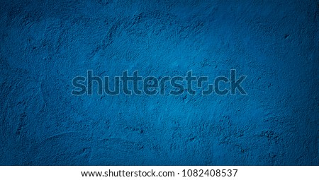 Abstract Grunge Decorative Relief Navy Blue Stucco Wall Texture. Wide Angle Rough Colored Background With spot light. Dark Background With Copy Space for design