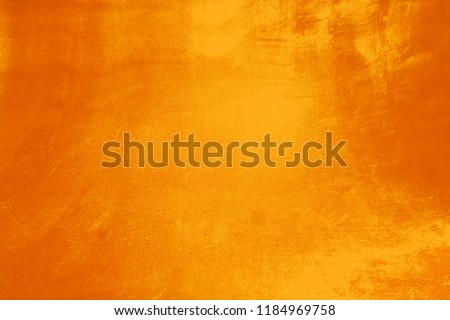 Abstract grunge surface orange gold background golden yellow highlights #1184969758