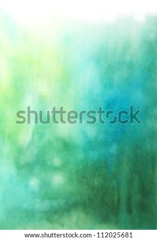 Abstract hand drawn watercolor background: blue and green blurs. Great for textures, vintage design, and luxurious wallpaper