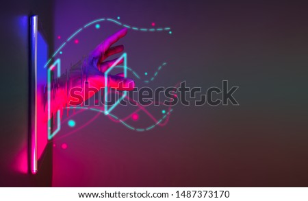 Photo of  Abstract hand get off from smartphone technology with neon graphic line. Futuristic cyberpunk colour network concept with copy space.