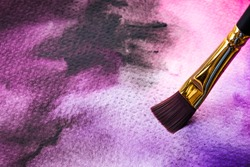 Abstract Hand painted Watercolor Colorful wet texture background with paint brushes on paper. picture for creative wallpaper or design art work. Pastel colors tone