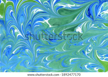 Abstract handmade background in ebru technique. Paper surface with an imprint of paints on water. Blue curls, waves and spots of different shapes and sizes. Unique art illustration Stok fotoğraf ©