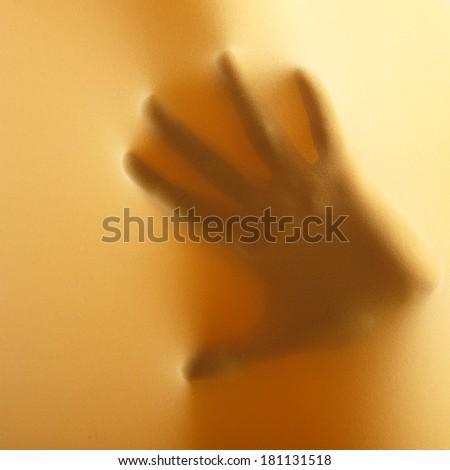 abstract hands, human arm inside yellow fabric, studio shot