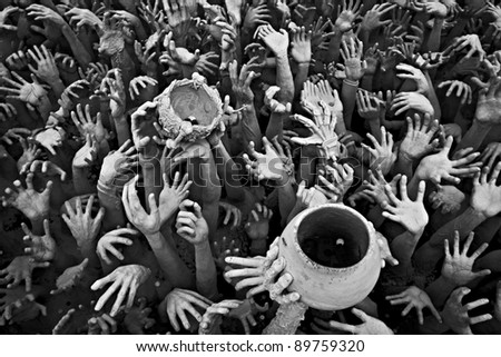 Abstract hands statue from Hell in Wat Rong Khun at Chiang Rai of Thailand