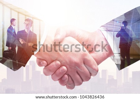 Abstract handshake on meeting city background. Teamwork and communication concept. Double exposure