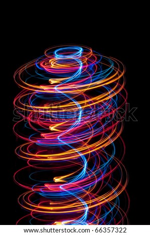 abstract helter skelter composed of spirals of glowing light