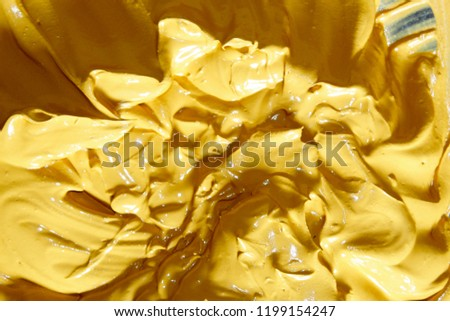 Abstract high resolution free Photo of a yellow abstract background.This is a liquid mixture of wet cement concrete and yellow Oxide Cement Colour Powder.Used for Concrete colour flooring. #1199154247