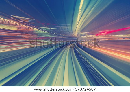 Abstract high speed technology POV motion blurred concept image from the Yuikamome monorail in Tokyo Japan