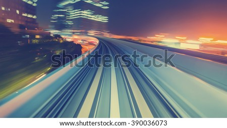 Abstract high speed technology POV motion blurred concept image from the Yuikamome monorail in Tokyo Japan #390036073