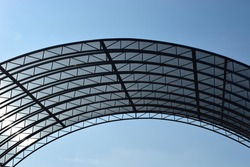 Abstract high-tech architecture background photo, internal structure of glass roof arch. Glass arch of the building with metal frames. Arched glass roof top close up view in modern building.