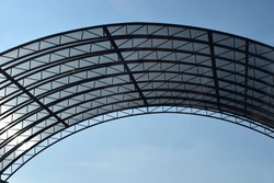 Abstract high-tech architecture background photo, internal structure of glass roof arch. Glass arch of the building with metal frames. Urban architecture of ceiling.
