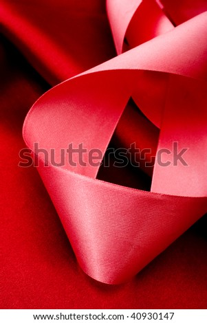 Abstract holiday background with pink ribbon