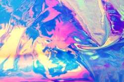 Abstract holographic background, bright iridescent neon colors, blurred, beautiful 90s style wallpaper, glowing festive gradient neon 90s. The texture of liquid metal, multi-colored foil. Place text.