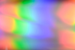 Abstract holographic disco background. Defocused Iridescent foil, trendy gradient.