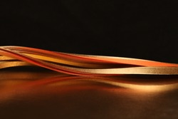 Abstract horizontal backgound. Gold (bronze) paper wave.