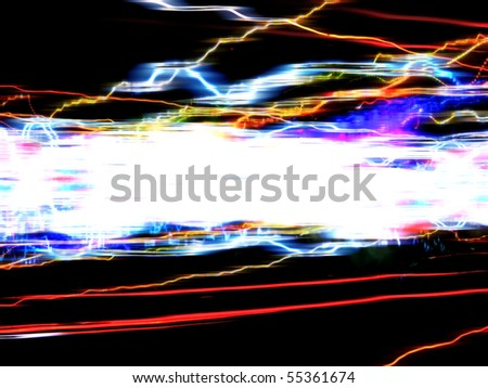 Abstract illustration of colorful glowing trails of light isolated over a black background.