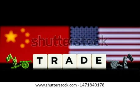 Abstract Illustrative Concept of Tariffs and Trade Wars between the USA and China with national flags in the background #1471840178
