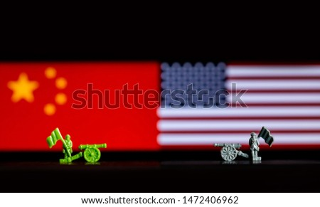 Abstract Illustrative Concept of Tariffs and Trade Wars between the USA and China with national flags in the background #1472406962