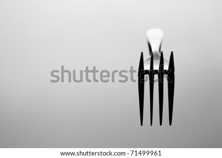 Abstract image for kitchen. Fork with reflection.