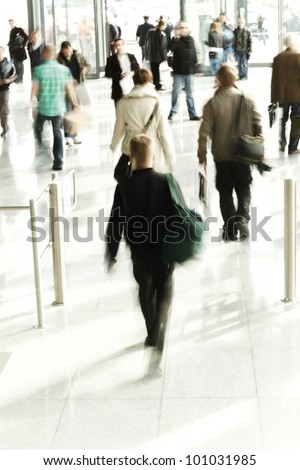 Abstract image of a business people rushing in the lobby in intentional motion blur - stock photo