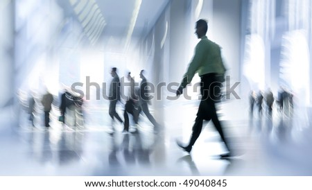 stock-photo-abstract-image-of-a-business-people-rushing-in-the-lobby-in-intentional-motion-blur-and-a-blue-tint-49040845.jpg