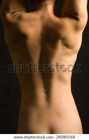 stock photo : Abstract image of a nude female back in color against black ...