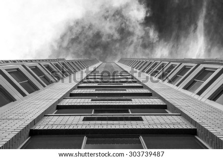 Abstract image of building exterior. Modern building facade with symmetrical design. Urban city background and design. Minimal architectural detail.
