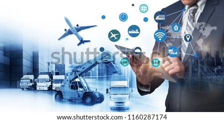 Abstract image of business man point to the hologram on smartphone and forklift handling container box loading for logistic import export and transport industry concept, internet of thing (iot) #1160287174