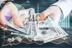 Abstract image of businessman counting dollar banknotes on forex background. Double exposure. Finance concept