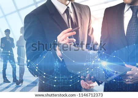 Abstract image of businessmen using laptop on abstract blurry background. Teamwork and media concept. Double exposure