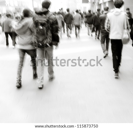 abstract image of city people rushing on the street blurred motion
