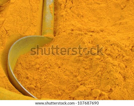 Abstract image of Indian turmeric powder from vegetable market.