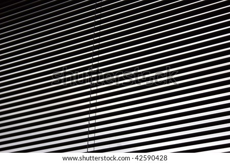 abstract image of mini blinds open in window forming dark and light lines. suitable as background image or wallpaper