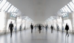 Abstract image of people in the lobby of the modern transport center of the airport bus and train station