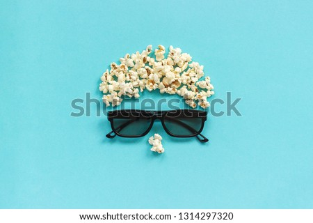 Abstract image of viewer, 3D glasses and popcorn on blue background. Concept cinema movie and entertainment Flat lay Top view Copy space Template for text or your design.
