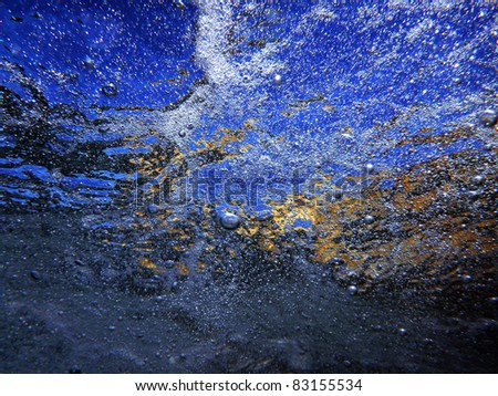 Abstract image showing reflections on sea surface shot from below